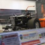 Dampende trekkers en vrachtwagens bij Tractorpulling  in TT Hall in Assen (Video)