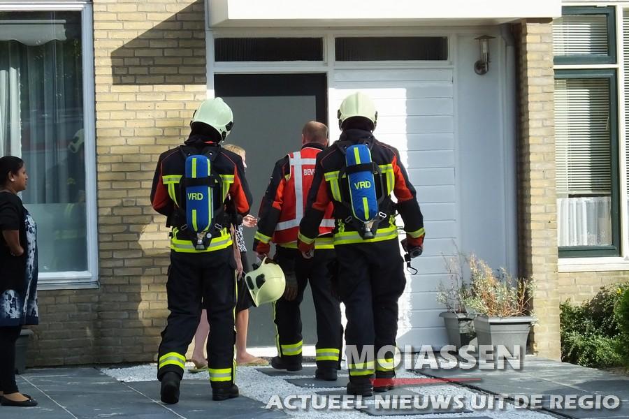 Brandweer controleert rookkanaal na vlam in de pan
