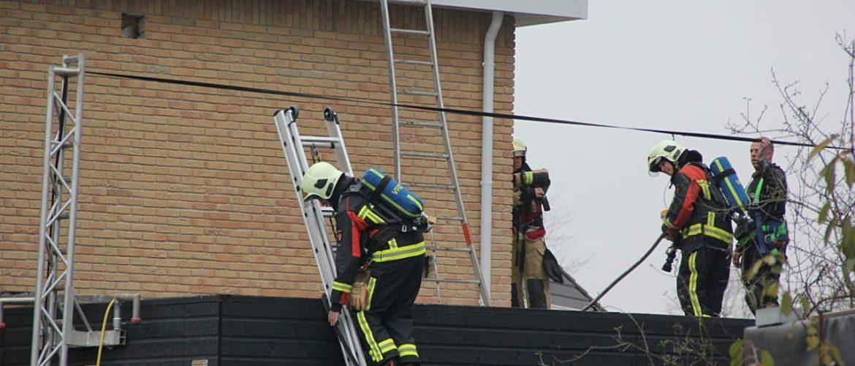 Brand in spouwmuur van woning in aanbouw aan de Mosklok in Assen